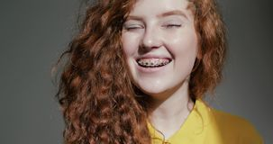 Portrait of a young girl laughing at the camera
