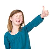 Portrait of a young girl laughing with thumbs up Stock Image
