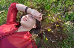 Portrait of young  girl  laying on grass Stock Image