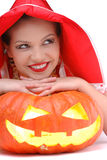 Portrait of young girl laying on halloween pumpkin Royalty Free Stock Images
