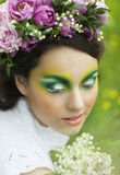 Portrait of a young girl with lily of the valley Stock Image