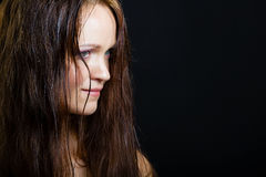 Portrait of a young girl with long wet hair on a black Royalty Free Stock Photo