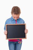 Portrait of a young girl looking at a school slate Royalty Free Stock Photos