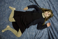 Portrait of young girl lying at the bed Stock Images