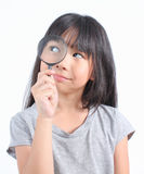 Portrait of young girl with magnifying glass Royalty Free Stock Photography