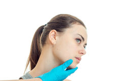 Portrait of a young girl without makeup which cocked her head at a cosmetologist close-up Stock Image
