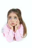 Portrait of young girl making faces. Over white Royalty Free Stock Photography