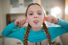 Young girl making funny faces at home Stock Photo