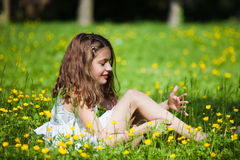 Portrait of a young girl in a meadow Royalty Free Stock Images