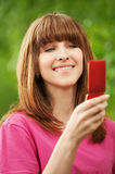 Portrait of young girl with mobile Royalty Free Stock Photography