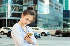Portrait of a young girl with a mobile phone. stock photography