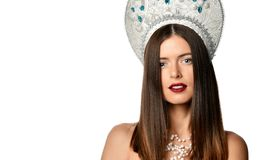 Portrait of young girl model in kokoshnik hat with natural makeup and long blowing hair isolated . Looking at camera. royalty free stock photography