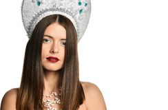 Portrait of young girl model in kokoshnik hat with natural makeup and long blowing hair isolated . Looking at camera. stock image