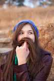 Portrait of a young girl with moustache Stock Photo