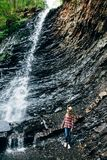 Portrait of young girl near waterfall royalty free stock image