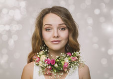 Portrait of a young girl in a necklace of roses Stock Photography