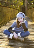 Portrait of a young girl on the old bridge Stock Photography