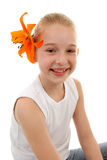 Portrait of young girl with orange lily Royalty Free Stock Image