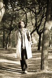 Portrait of a young girl at outdoor, Vintage. Portrait of a young girl in cloak at outdoor. Photo in retro style Royalty Free Stock Photos