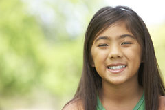 Portrait Of Young Girl In Park Royalty Free Stock Photo