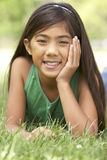 Portrait Of Young Girl In Park Royalty Free Stock Photography