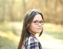 Portrait of a young girl in park royalty free stock images