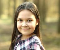 Portrait of a young girl in park stock image