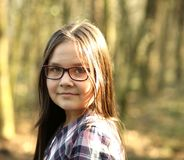 Portrait of a young girl in park stock images