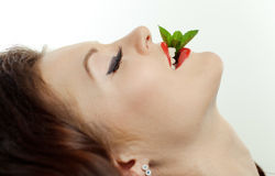 Portrait of a young girl with  peppermint Royalty Free Stock Photo