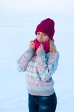 Portrait of young girl in pink hat and scarf in the winter fores. T Stock Photo