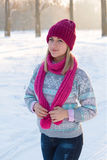 Portrait of young girl in pink hat and scarf in the winter fores Royalty Free Stock Images