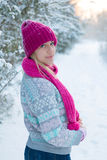 Portrait of young girl in pink hat and scarf Stock Photo