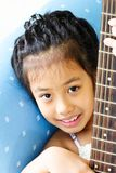 Portrait young girl play with guitar Stock Images