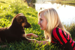 Portrait young girl playing with puppy Royalty Free Stock Photo