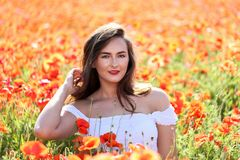 Portrait of a young girl .The girl in the poppy field.  stock images