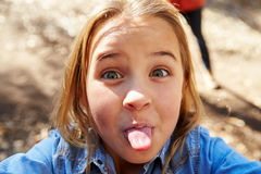 Portrait Of Young Girl Pulling Face For Selfie Photograph royalty free stock images