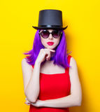 Portrait of young girl with purple color hair and Top hat Stock Image