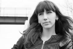Portrait of young girl at the railway bridge Stock Photo