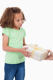 Portrait of a young girl receiving a gift Stock Images