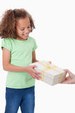 Portrait of a young girl receiving a present Royalty Free Stock Photo