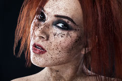 Portrait of young girl with red hair and ground coffee on the face. Photo with art makeup. Mature woman making cosmetic mask. Face stock photo