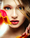 Portrait of young girl with tulip Stock Photos