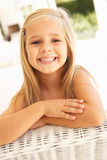 Portrait Of Young Girl Relaxing On Sofa Royalty Free Stock Image