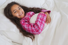 Portrait of a young girl resting in bed Royalty Free Stock Photos