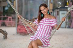 Portrait of a young girl resting in a hammock on the background of the camp.close up stock photography