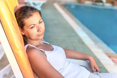 Portrait of young girl resting on a sun lounger Royalty Free Stock Photos