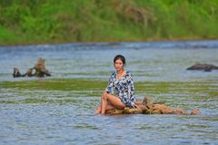 Portrait of young girl in river royalty free stock image