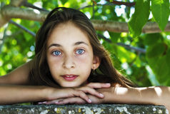 Portrait young girl's hand of the chin in summer Stock Image