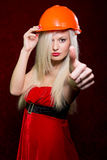 Portrait of a young girl in a Santa suit and helmet of the build Royalty Free Stock Photography
