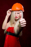 Portrait of a young girl in a Santa suit and helmet of the build Stock Images